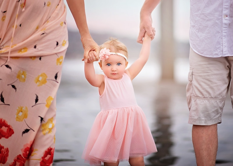 Family Photography, close up of little girl in pink at the beach