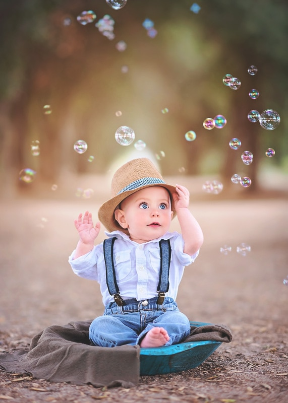 Child Photography, Baby boy looking up at all the bubbles in amazement while grabbing his fedora hat portrait