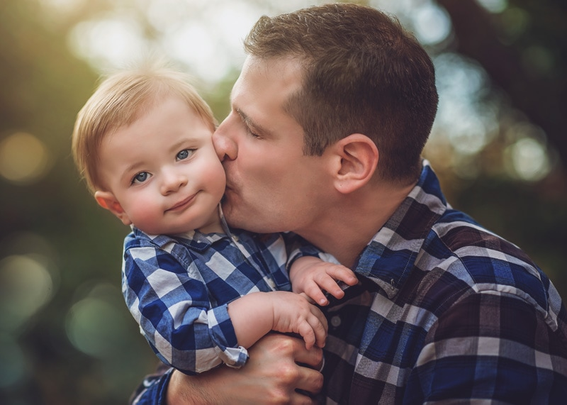 Family Photography, father giving little boy kiss on the cheek