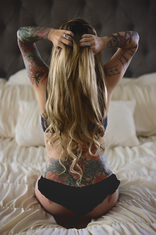 Boudoir Photography - behind shot of tattooed woman on bed - Temecula California Boudoir Photographer