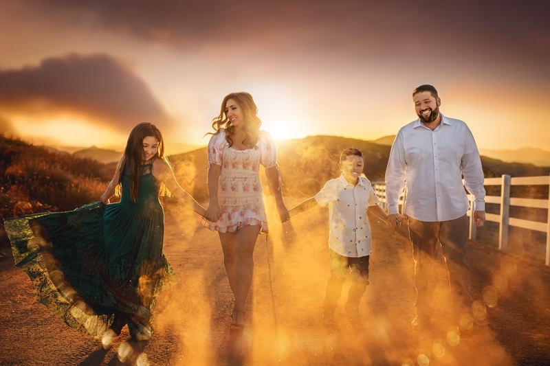 A gorgeous family silhouetted by the golden sunset surroundings in Temecula California
