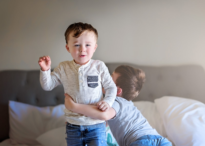 Lifestyle Photography, little brothers playing on bed together