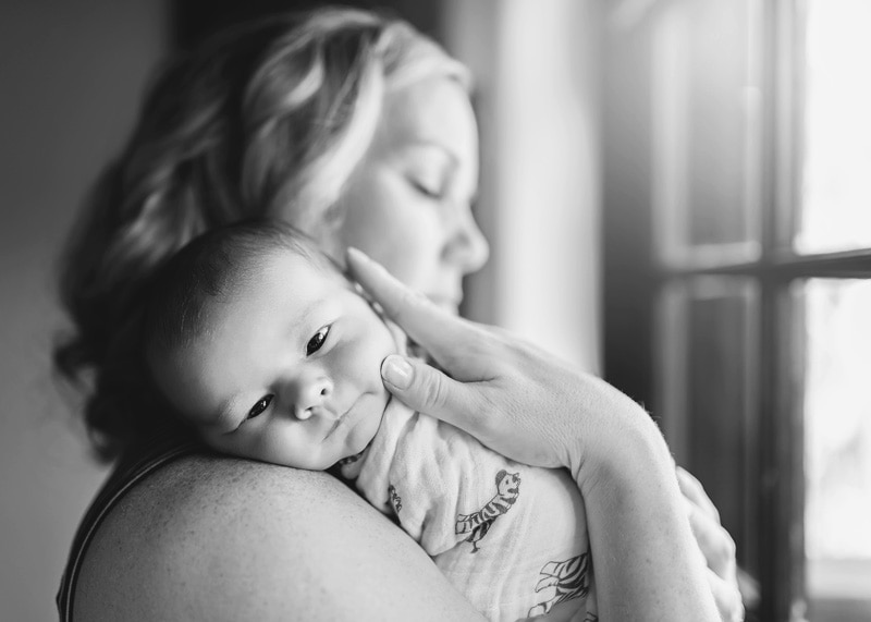 Lifestyle Photography, black and white of baby on mother's shoulder
