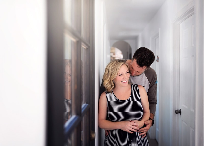 Lifestyle Photography - husband and wife cuddling in hallway - Temecula California Lifestyle Photographer