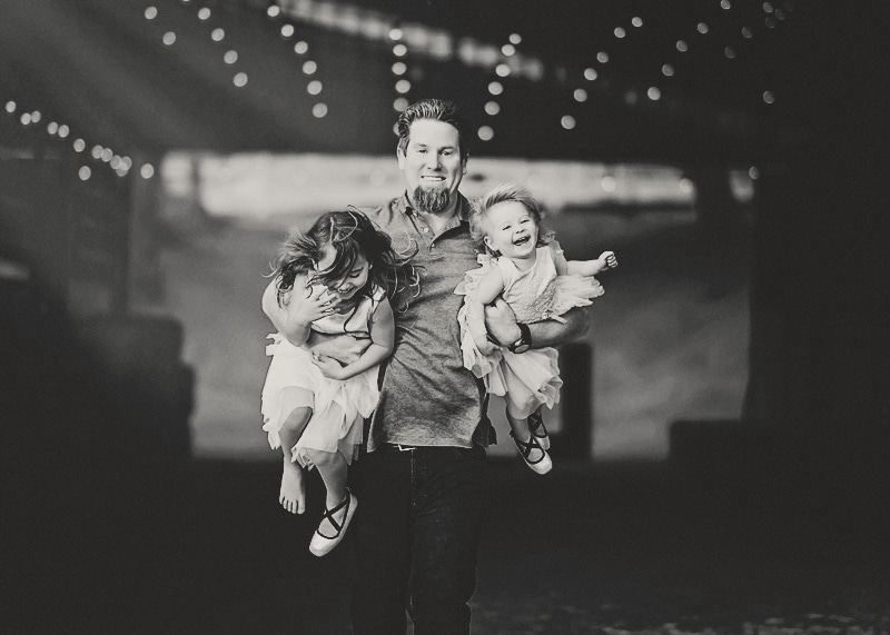 Family Photography, black and white image of father holding two daughters