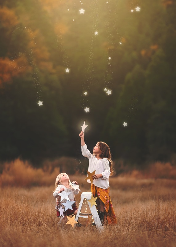 Child Photography, Toddler girls playing in a field catching silver and golden stars as they fall from the sky portrait