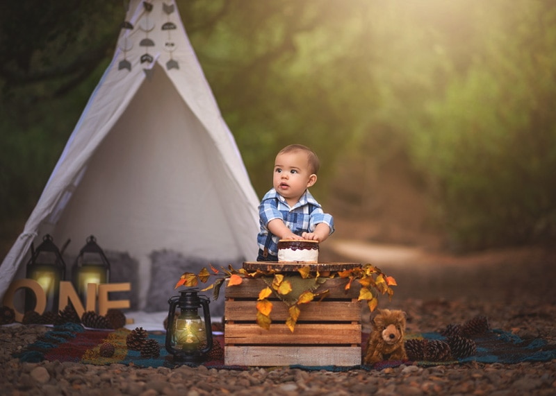 Child Photography, Baby boy smashing a s'mores smash cake for his into the wild camping milestone portrait