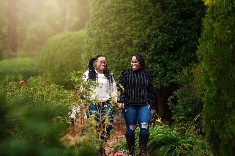 A beautiful candid moment between a mother and daughter walking through a botanical garden setting in Temecula California