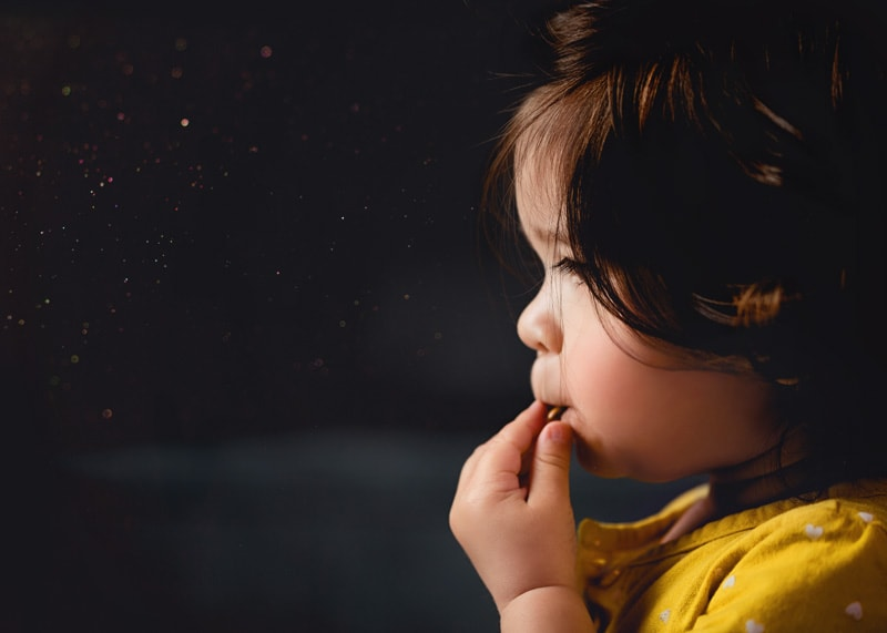 Child Photography, Moody and bold colors of profile of toddler girl