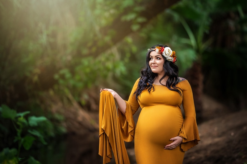 Beautiful Outdoor Pregnancy Portrait in Maternity Gown with Flower Crown