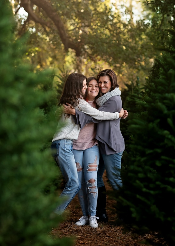 Family Photography, mother and daughters hugging