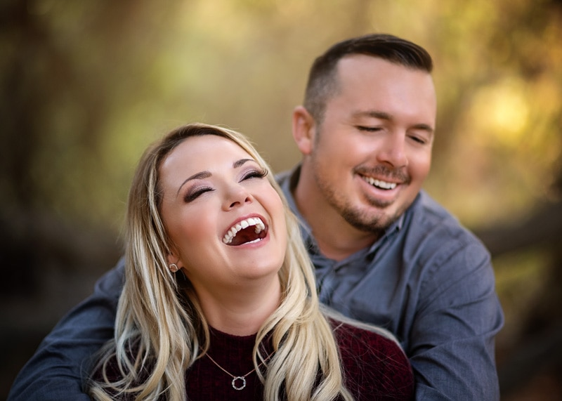 Couples Photography, Couple embracing each other hysterically laughing portrait