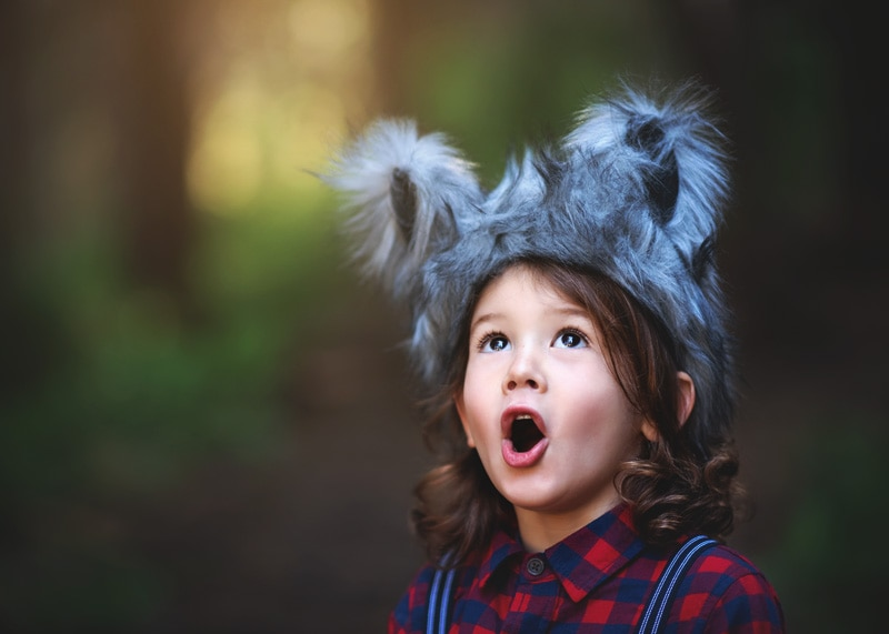 Child Photography, Toddler boy howling up in the deep dark forest dressed as the big bad wolf portrait