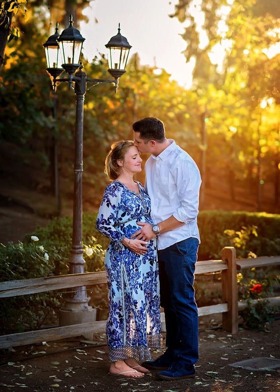 Maternity photography, couple standing next to lamppost