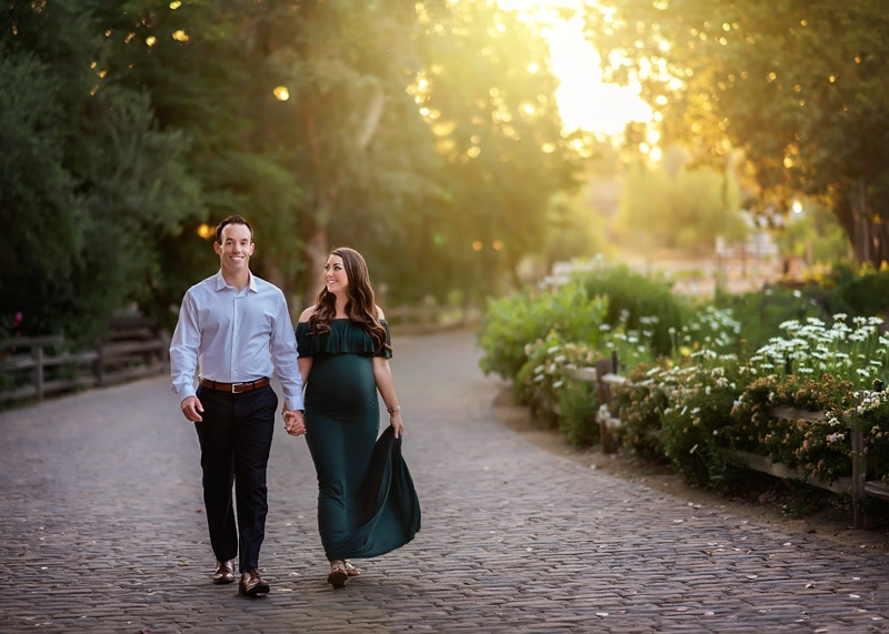 Maternity Photography - husband and wife walking down cobblestone path - Temecula California Maternity Photographer