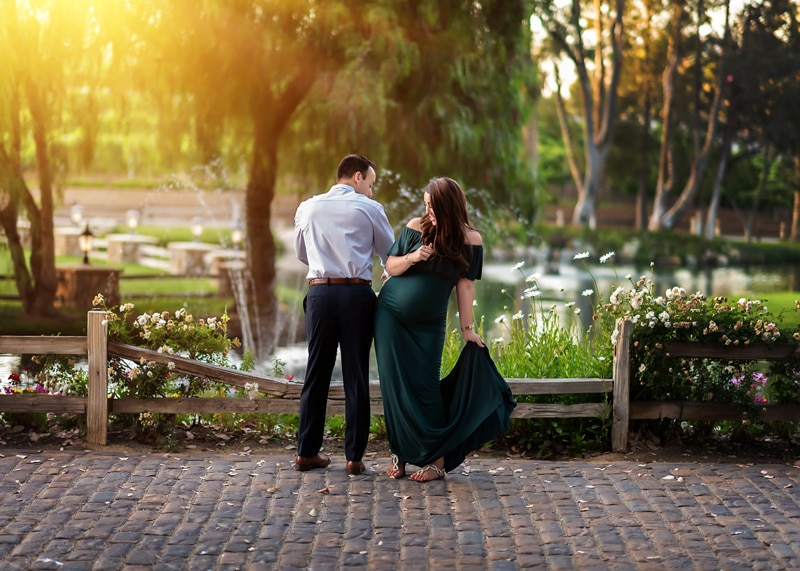 Maternity Photography - husband and wife bumping hips playfully - Temecula California Maternity Photographer