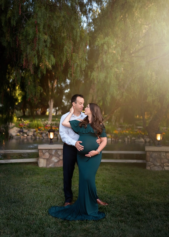 Maternity Photography - husband and wife in green floor length dress - Temecula California Maternity Photographer