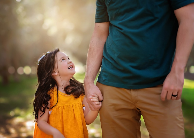 Family Photography - little girl in yellow looking up at daddy - Temecula California Family Photographer