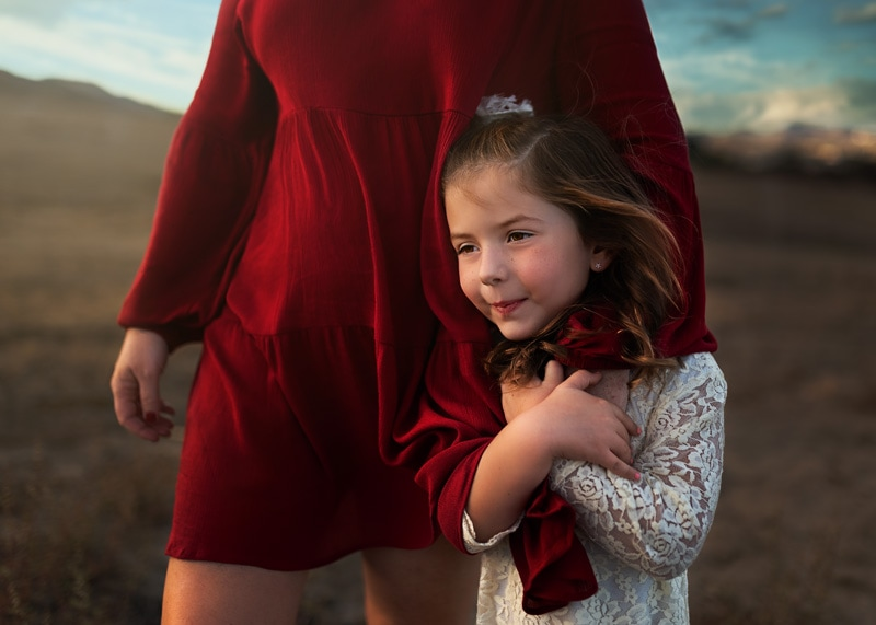 Family Photography, close up of daughter with mother wearing red