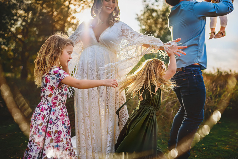 Beautiful Outdoor Pregnancy Family Portrait in Boho Maternity Gown