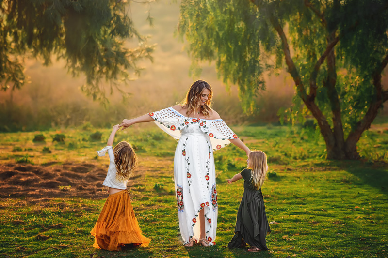 Beautiful Outdoor Family Pregnancy Portrait in Maternity Gown