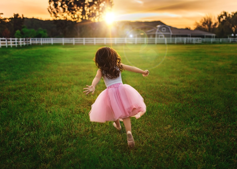 Pink Tutu Golden Sunset Candid of Little Girl Running in Grass