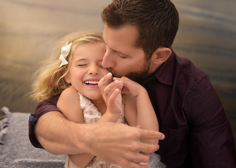 Family Photography, close up of father giving his daughter a kiss on the cheek