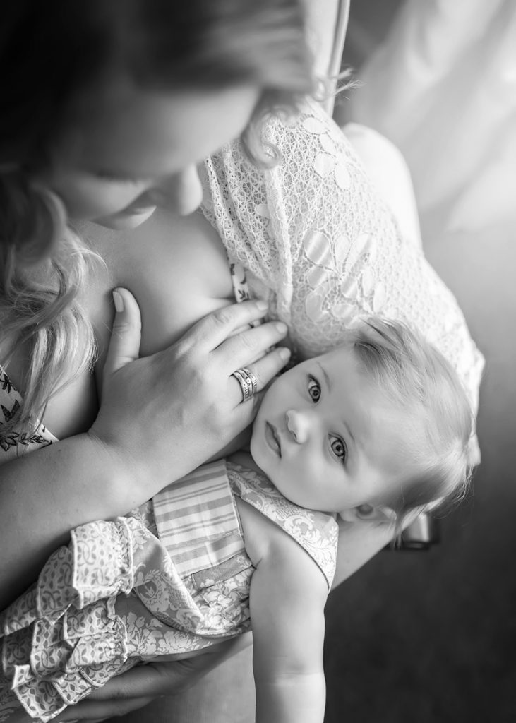 Lifestyle Photography - black and white of baby girl breastfeeding - Temecula California Lifestyle Photographer