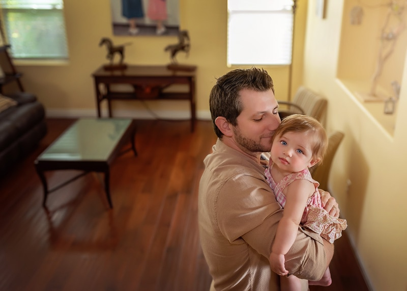 Lifestyle Photography, baby girl in the arms of her daddy