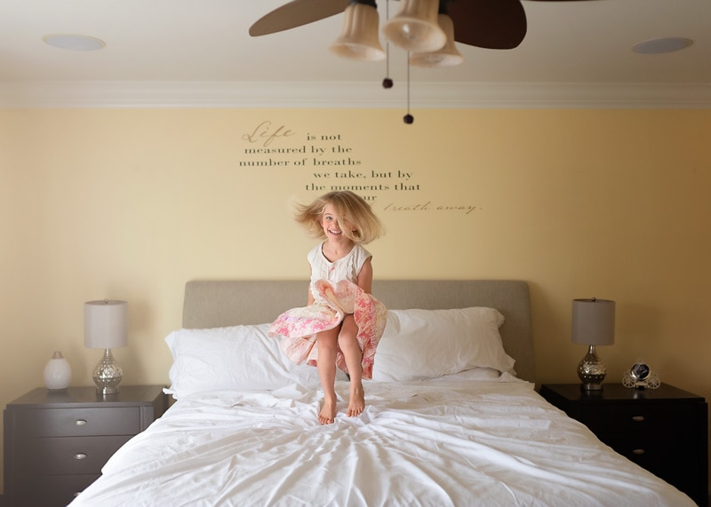 Lifestyle Photography, little girl jumping on bed