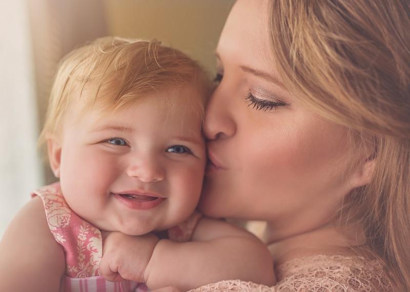 Lifestyle Photography - mama kissing smiling baby girl - Temecula California Lifestyle Photographer