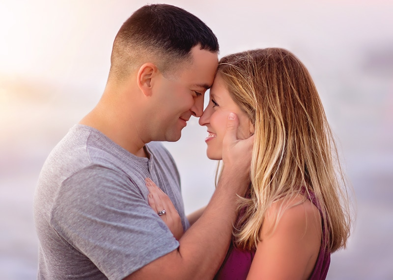 Couples Photography, Couple embracing each other forehead to forehead smiling and giggling at each other at the beach portrait