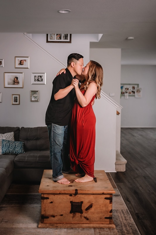 A couple slow dancing on their coffee table in an in home lifestyle session in Temecula
