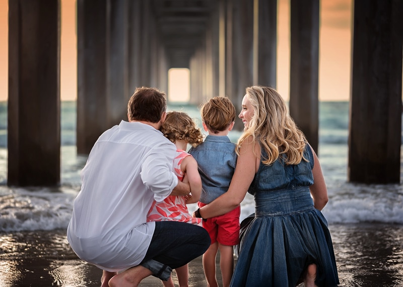 Family Photography, shot of family from behind under the pier