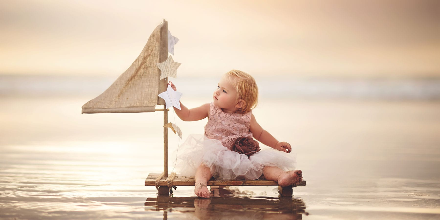 Child Photography, little girl sitting on a raft
